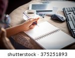 woman left hand writing on... | Shutterstock . vector #375251893