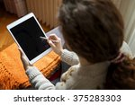 woman using digital tablet with ... | Shutterstock . vector #375283303