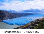 grey glacier at evening time.... | Shutterstock . vector #375294157