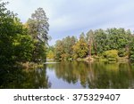 pond and trees in the park.... | Shutterstock . vector #375329407