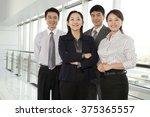 business team looking at camera   Shutterstock . vector #375365557
