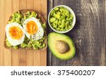 toast with avocado and egg on... | Shutterstock . vector #375400207