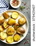baked potatoes with rosemary | Shutterstock . vector #375425407