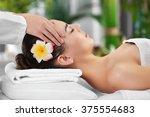 beautiful young woman relaxing... | Shutterstock . vector #375554683
