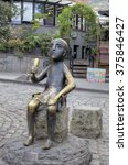 Small photo of Tbilisi, Georgia - September 14, 2015: Tamada - sculpture of a man holding a horn in Tbilisi modeled on an ancient Colchian statuette.