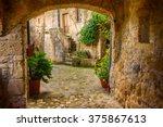 narrow street of medieval tuff... | Shutterstock . vector #375867613