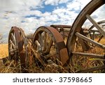 Old Wagon Wheels On A Farm.