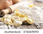 italian tortellini on wooden...   Shutterstock . vector #376069093