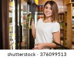 cute young woman buying some... | Shutterstock . vector #376099513