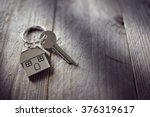 house key on a house shaped... | Shutterstock . vector #376319617