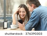 cheerful couple laughing... | Shutterstock . vector #376390303