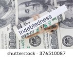 Small photo of Money and business idea, The dollar bills tied with a rope, with a sign - Indebtedness