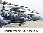 Small photo of Helicopters and planes in row, military copters and bomber jets and reconnaissance aircrafts, air force, modern army aviation and aerospace industry