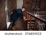 Young Hipster Man On Stairs...