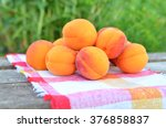 Fresh Apricots On A Wooden...