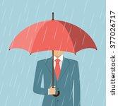 businessman holding an umbrella.... | Shutterstock .eps vector #377026717