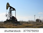 silhouette of small pump jack | Shutterstock . vector #377075053