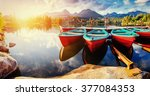 boat on the dock surrounded... | Shutterstock . vector #377084353