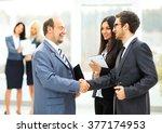 meeting business partners in... | Shutterstock . vector #377174953