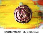 photo of artichokes on yellow... | Shutterstock . vector #377200363