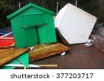two storm damaged beach huts... | Shutterstock . vector #377203717