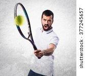 tennis player over textured... | Shutterstock . vector #377245657