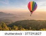 hot air balloon above high... | Shutterstock . vector #377291827