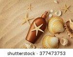 suntan cream bottle on sand... | Shutterstock . vector #377473753