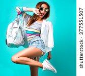 fashion studio portrait of... | Shutterstock . vector #377551507
