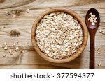oat flakes in a round bowl on... | Shutterstock . vector #377594377
