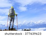 young woman hiker looking at... | Shutterstock . vector #377639623