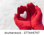 Little Girl Holding Snow Heart...