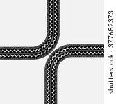 black tire tracks in cross form ... | Shutterstock .eps vector #377682373