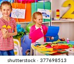kids learning do origami by... | Shutterstock . vector #377698513