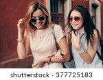 two young women walking... | Shutterstock . vector #377725183