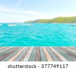 wood table top with blurred... | Shutterstock . vector #377749117