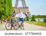 romantic couple riding bicycles ... | Shutterstock . vector #377784403