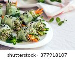 raw vegan rolls with sprouted... | Shutterstock . vector #377918107