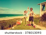 blurred siblings freedom beach... | Shutterstock . vector #378013093
