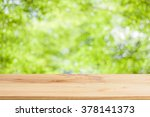 wood table top on bokeh green... | Shutterstock . vector #378141373