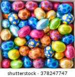 Chocolate Eggs In Colorful Foi...