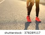 woman runner hold her injured... | Shutterstock . vector #378289117