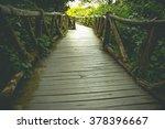 Wooden Bridge In Misty Tropica...
