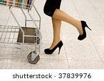 woman rolls the shopping cart... | Shutterstock . vector #37839976