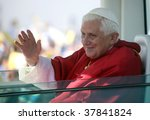 BRNO - SEPT 27: Holy father Pope Benedict XVI gestures as he greets about 120,000 pilgrims from central Europe as he travels in the Pope Mobile on mass on September 27, 2009 in Brno, Czech Republic. - stock photo