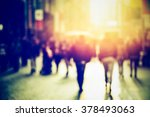 Stock photo people walking in the street blurry 378493063