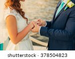 he puts on a wedding ring | Shutterstock . vector #378504823