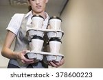woman carrying coffee cups | Shutterstock . vector #378600223