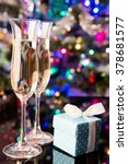 two glasses of champagne and a... | Shutterstock . vector #378681577