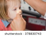 doctor ent checking ear with...   Shutterstock . vector #378830743